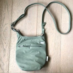 Pacsafe anti-theft green crossbody purse